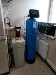 Замена фильтрующей загрузки в системе водоочистки в частном доме